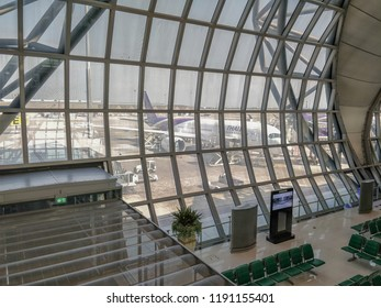 Bangkok, Thailand-March 18, 2018: Suvarnabhumi Airport boarding zone. The side wall of the boarding zone made of glass framing. The passengers can enjoy the view of the airfield and airplanes.