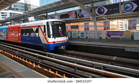 BANGKOK, THAILAND-MARCH 27, 2014: BTS Sky train arrives to Phloen Chit station. Elevated rails cover business, resident, and tourist areas by 32 stations.
