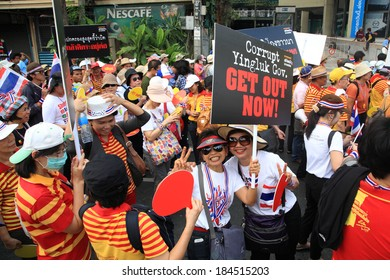 BANGKOK, THAILAND-MARCH 29, 2014: Unidentified Thai protestors raising get out Yingluck banner. More than million people rally around Bangkok streets today.