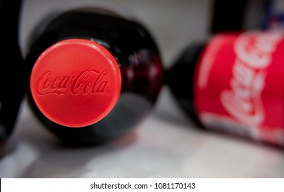 BANGKOK, THAILAND-MAY 1, 2018: Bottle of Coca-Cola with at shelf at shopping mall background. Coca-Cola is a carbonated soft drink sold in stores, throughout the world.