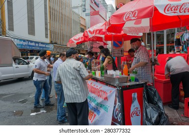 """BANGKOK THAILAND-MAY 22: Thai Sikhs distributed free beverages to the general public commuters passing The day commemorate the """"conscripted escort justified"""" On May 22,2015 at phahurat road Thailand"""