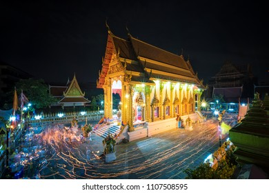 Bangkok, Thailand-May 29, 2018:The devout Buddhists walking three times around the principle chapel clockwise, each clasping three incense sticks, a lighted candle and lotus buds on Visakha Bucha Day.
