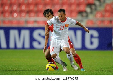 BANGKOK THAILAND-NOV 24:Nguyen Tr?ng Hoang of Vietnam (white) runs with the ball during the AFF Suzuki Cup between Vietnam and Myanmar at Rajamangala stadium on Nov24, 2012 in Bangkok,Thailand.