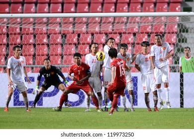 BANGKOK THAILAND-NOV 24:Pyae Phyo Aung #13 of Myanmar (red) shoot the ball during the AFF Suzuki Cup between Vietnam and Myanmar at Rajamangala stadium on Nov24, 2012 in Bangkok,Thailand.