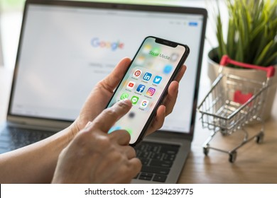 BANGKOK, THAILAND-November 19, 2018: Social media app multi-channel icons on iphone X touchscreen mobile computer cross-channel internet application technology shopping lifestyle in digital 4.0 age