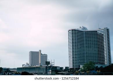 BANGKOK, THAILAND-NOVEMBER 23,2018 : Modern glass business office building skyscrapers over blue cloudy sky in evening at Bangkok Thailand