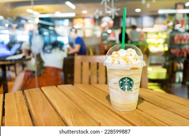 Bangkok ,Thailand-November 6 : Glass of Starbucks Coffee Frappuccino Blended Beverages at wood table in starbuck shop on 6 November 2014 at Queen Sirikit National Convention Center, Bangkok, Thailand.