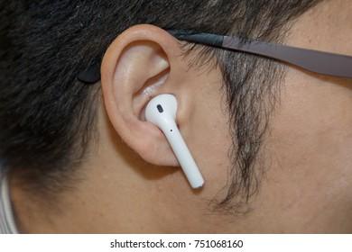 BANGKOK, THAILAND-NOVEMBER 8: Close-Up on The Bluetooth  Apple AirPods on a man's ear on November 8,2017