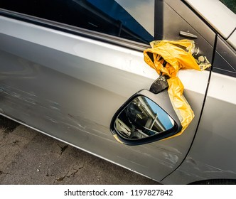Bangkok Thailand-OCT-06-2018;Broken Side wing mirror with Automotive Maintenance was hit and the door of the driver's side was hit cause abrasion  by a motorcycle at Business District sukhumvit road.