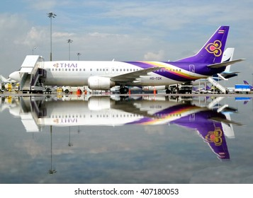 Bangkok, Thailand-October 10,2014:Thai Airways Boeing 737-400 (HS-TDK) stand by for departure ay Suvarnabhumi Airport after rain.
