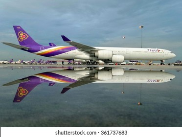 Bangkok, Thailand-October 13,2014:Thai Airways Airbus A340-600(HS-TNF) parking after heavy rain in the morning at Suvanabhumi Airport.