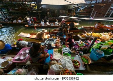 Bangkok, Thailand,October 15 10 2014:Bangkok floating market local food Thai vendors selling fruits fantastic beautiful place in Thailand