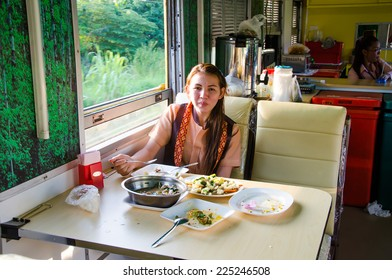 BANGKOK, THAILAND-OCTOBER 20: Passengers having dinner in the dining car on the train, on the way between Chiang Mai to Bangkok on October 20, 2014 , Bangkok Thailand