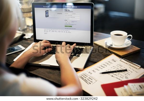 BANGKOK, THAILAND-October 2,2015: Young Woman Using Facebook Application on her Laptop