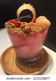 Bangkok ,Thailand,September 26 2018 A glass of rose ice cream with lychee bingsu.bingsu with strawberry is on table in swensen's restaurant