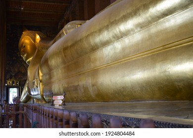 Bangkok, Thailnd- June 22, 2019: The giant statue of the golden recling buddha at Wat Pho or Pho Temple in Bangkok, Thailand
