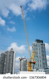 in Bangkok there is this beautiful construction crane on a construction site