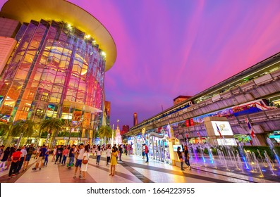 Bangkok, Thialand - January 1,2020:Peoples visit Siam Paragon, is one of the most popular shopping malls is famous with color of light of fountain outdoor and Biggest Shopping Center in Thailand