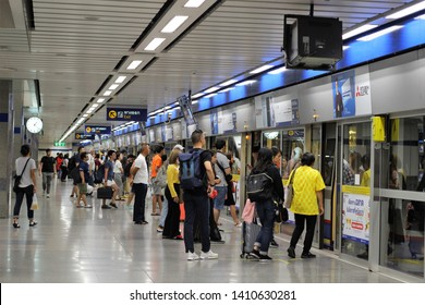 Bangkok, Thialand - May 27 2019: People in Bangkok standing in que for the train at Chatuchak MRT station. MRT is an underground railway system which runs rapidly and is faster in connecting the city