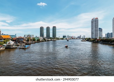 Bangkok urban landscapes with blue sky and the riverside modern  building