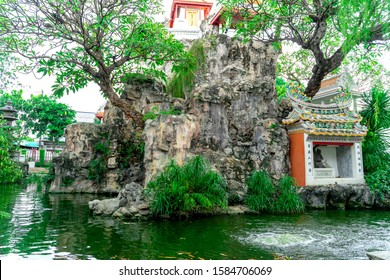 Bangkok Yai, Bangkok September 23,2018 The atmosphere of the temple garden decorated with chinese styles. there is an is land in the middle. there is a small shrine. with a stature of a god shade cool
