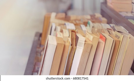 Bangkok(17 Jul 17) - (Very bright, soft shot) Small used book shop put books on discount in a basket and located it on sidewalk outside shop to attract passersby to visit the shop and buy their books