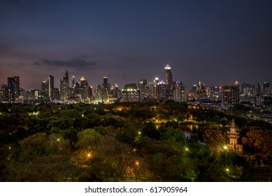 BANGKOK-APR 1, 2017: Night time Bangkok City scape with Lumpini park and buildings in the background. There are 10 millions people living in Bangkok, Thailand