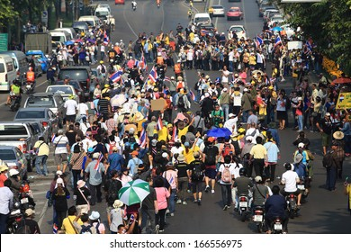 BANGKOK-DECEMBER 9 :Anti-government protesters rally outside Government House on DECEMBER 9, 2013 in Bangkok,Thailand. The movement is known as the People's Democratic Force to Overthrow Thaksinism