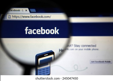 BANGKOK-JANUARY 17 2015: Magnifying Facebook.com Home Page. Facebook is an online social networking service headquartered in Menlo Park, California.