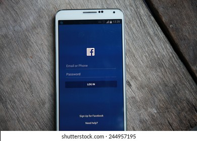 BANGKOK-January 18 2015: Facebook's Log In Home Page on Mobile Phone. Facebook is is an online social networking service headquartered in Menlo Park, California.
