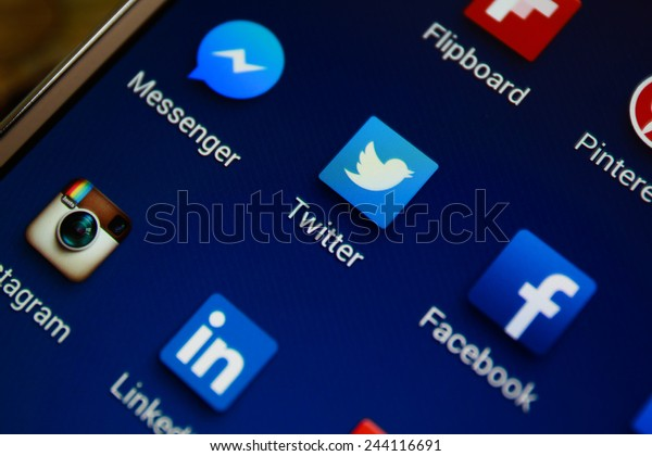 """BANGKOK-JANUARY11 2015: Twitter Icon on Phone. Twitter is an online social networking service that enables users to send and read short 140-character messages called """"tweets""""."""