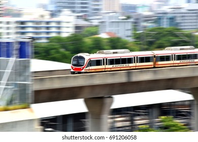 The Bangkok's Airport Rail Link, an express and commuter rail, linking an airport to city center, operating on an elevated track, motion blur