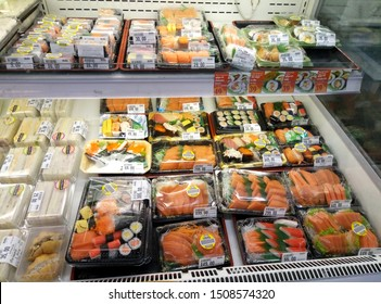 Bangkok/Thailand- 03/03/2017: Sets of chilled sushi and fresh fish in plastic boxes in a supermarket refrigerator.