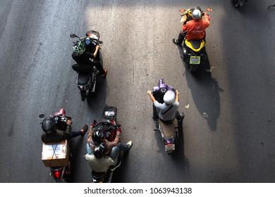 Bangkok,Thailand, - 06 April 2018 : Crowd of motorbikes drive waiting for green traffic light on Rama I Road under BTS Sky Train Siam Interchange Station  Bangkok, Thailand