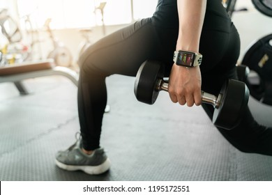 Bangkok,Thailand ,1 Oct 2018 : Close up of apple watch activity screen young woman dumbbell workout fitness gym