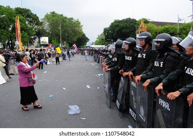 Bangkok/Thailand - 11 24 2012: Riot police face protesters at Royal Plaza.