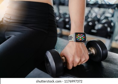 Bangkok,Thailand ,11 Sep 2018 : Close up of Apple Watch Home Apps screen View woman dumbbell workout fitness gym