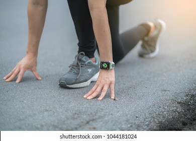 Bangkok,Thailand ,12 mar 2018 : Asia woman sport ware ready for run with apple watch smart watch