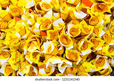 BANGKOK-THAILAND 14/11/2018:Ancestor deceased Joss Paper for burning on  Qing Ming day-Chinese funeral day.Gold paper offering Ghost Festival.people pay homage their deceased ancestor