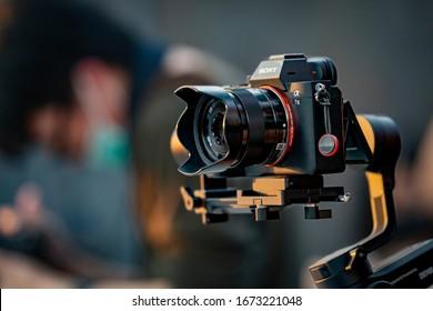 Bangkok,Thailand 2 February 2020: Videoman holding FILMING WITH DJI RONIN M handheld AND SONY A7R mark III. Full-Frame Exmor R BSI CMOS Sensor. Alpha Fast focusing 4K-shooting Digital Camera ILCE-7RM3