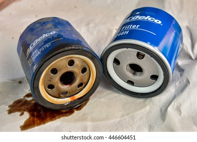 BANGKOK,THAILAND - 22 JUNE 2016 : Old dirty car oil filter VS new oil filter (AcDelco oil filter PF288H for Aveo, Lova, Excelle 1.6), automotive maintenance service