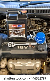 BANGKOK,THAILAND - 22 JUNE 2016:The equipments for refiling motor oil(Amsoil Signature0w30) in the car engine(Chevrolet Aveo), ACDELCO oil flter, Oil Filter Cap Wrench, funnel and socket wrench(Koche)