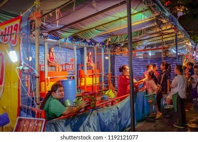 "Bangkok/Thailand - 24 November 2015:Thailand Dunk tank girl in ""Loi Krathong"" Temple Fair of wat saket temple.Bangkok city Thailand"