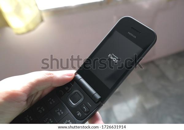 Bangkok/Thailand - 6 May 2020: Holding Nokia 2720 flip phone with kaios 4G
