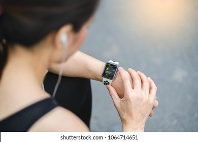 Bangkok,Thailand ,9 Apr 2018 : Woman choose Activity App outdoor run program on Apple Watch before run Working out