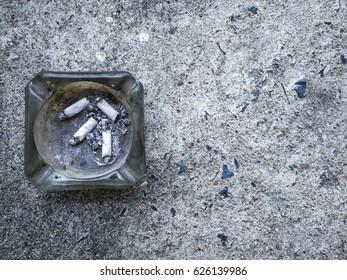 Bangkok,Thailand -Apr 22,2017- The ashtray on the cement floor.