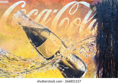 BANGKOK,THAILAND -APR 6: Old rust condition vintage wall of Coca Cola logo. on April 6, 2015 in Bangkok Thailand.