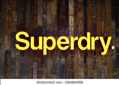 BANGKOK,THAILAND - April 04,2019 :  Superdry store sign on the wooden wall at central ladprao mall, Superdry is a world famous UK based fashion brand combining American and Japanese clothes styles