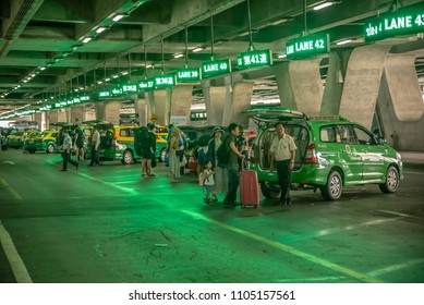Bangkok,Thailand - April 13,2018 : Airport taxi station with passengers in Bangkok Suvarnabhumi international airport,Bangkok,Thailand.
