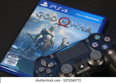 BANGKOK,THAILAND- APRIL 20: The New Ps 4 God of War 4 game with the Controller on April 20,2018